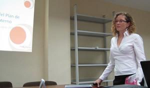 Laura speaking in town hall meeting